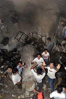 Palestinian enjoying the fire